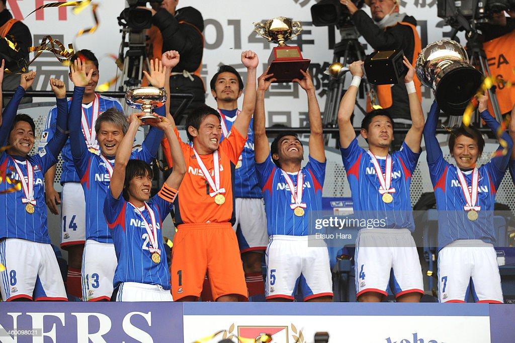 Captain Shunsuke Nakamura and Yokohama F.Marinos players celebrate the win after the 93rd Emperor's Cup final between Yokohama F.Marinos and Sanfrecce Hiroshima at the National Stadium on January 1, 2014 in Tokyo, Japan.