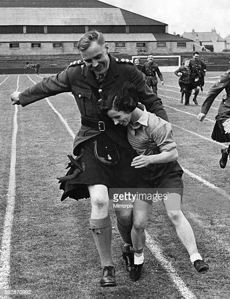 Captain Smith of the Black watch seen here with volunteer Fachie competing in the three legged race at the Black watch regimental games June 1941...