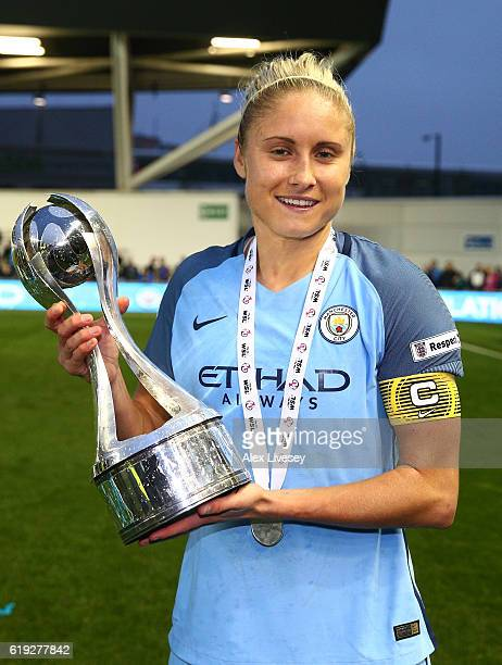 Captain Steph Houghton of Manchester City poses with the Women's Super Leauge1 trophy during Women's Super League1 match between Manchester City and...