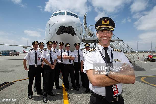 Captain Stephen Paul and Qantas pilots pose with the Qantas Mo Plane at Perth Airport on November 10 2014 in Perth Australia