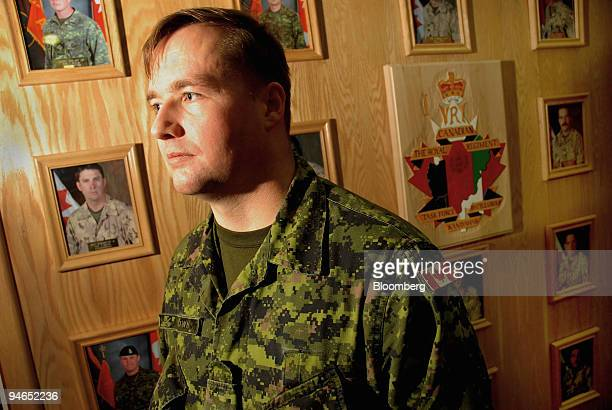 Captain Steve Brown of the Royal Canadian Regiment stands in front of a memorial for soldiers killed in Afghanistan at the Petawawa military base in...