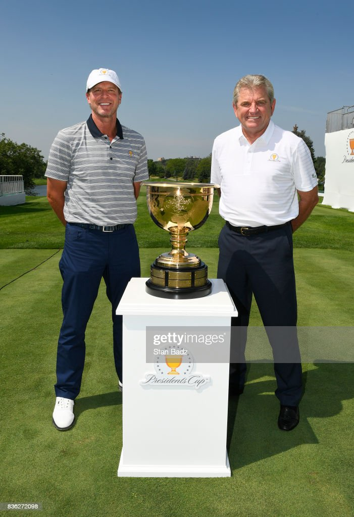 Captain Steve Stricker of the United States Presidents Cup Team and Captain Nick Price of the Presidents Cup International Team pose with the Presidents Cup trophy during the Presidents Cup media day at Liberty National Golf Club, host course of the 2017 Presidents Cup in Jersey City, New Jersey on August 21, 2017.