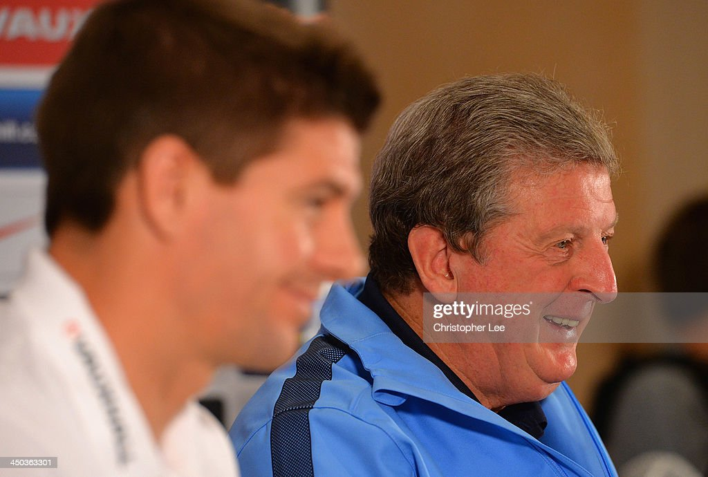 Captain Steven Gerrard listens to manager Roy Hodgson during England Press Conference at London Colney on November 18, 2013 in St Albans, England.