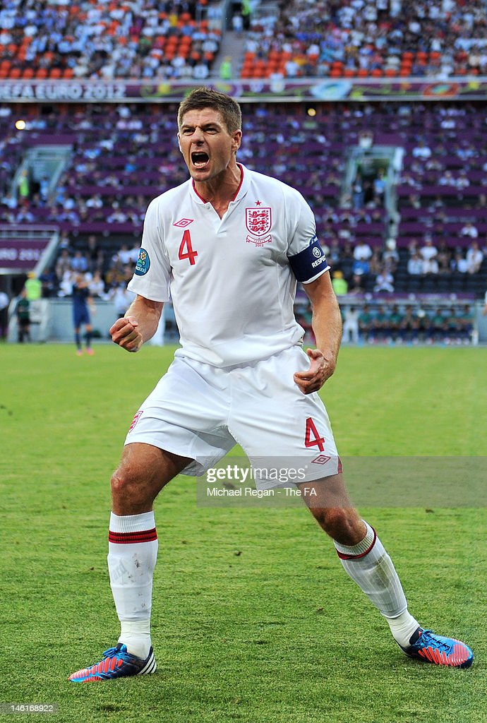 Captain Steven Gerrard of England celebrates after Joleon Lescott of England scored the first goal during the UEFA EURO 2012 group D match between...