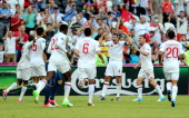 Captain Steven Gerrard of England celebrates with the team after Joleon Lescott of England scored the first goal during the UEFA EURO 2012 group D...