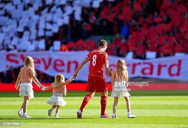 Captain Steven Gerrard of Liverpool walks onto the pitch with his daughters LillyElla Lourdes and Lexie during the Barclays Premier League match...