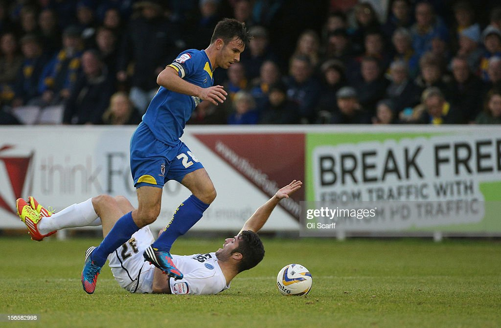 Captain Steven Gregory (blue) of AFC Wimbledon wins the ball from Daniel Lopez of Aldershot Town during the npower League Two match between AFC Wimbledon and Aldershot Town at the Cherry Red Records Stadium on November 17, 2012 in Kingston upon Thames, England.