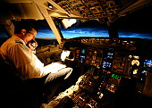 Captain talking to ATC with sunrise behind