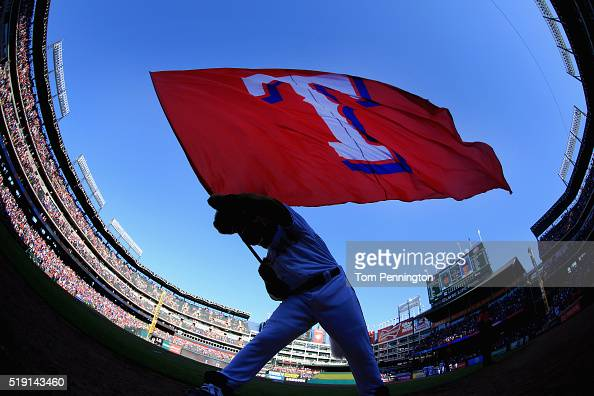 Captain the Texas Rangers mascot waves the team flag after the Texas Rangers beat the Seattle Mariners 32 on Opening Day at Globe Life Park in...