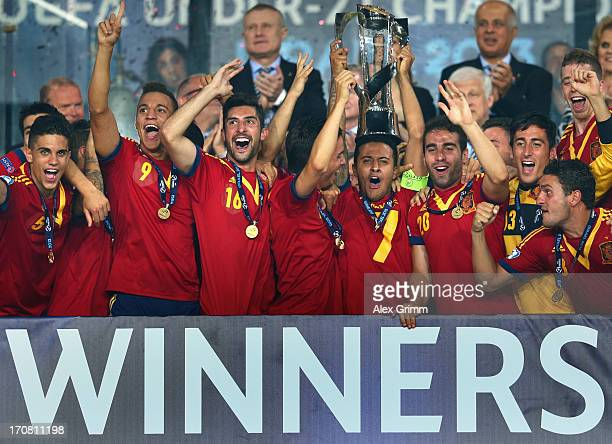 Captain Thiago Alcantara of Spain lifts the trophy after winning the UEFA European U21 Championship final match against Italy at Teddy Stadium on...
