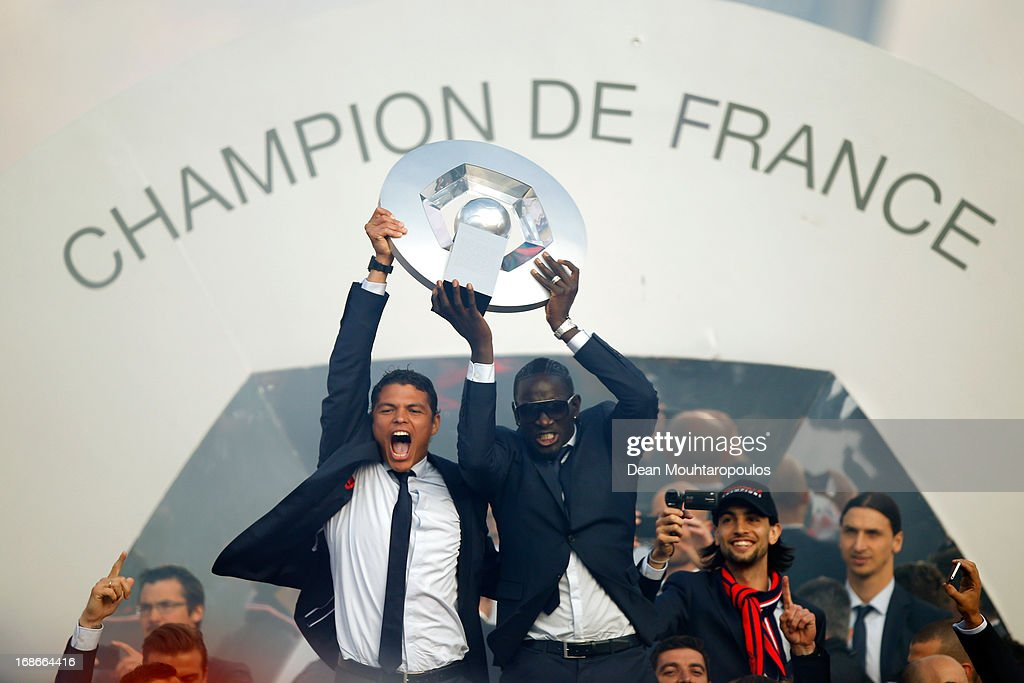 Captain, Thiago Silva (L) and <a gi-track='captionPersonalityLinkClicked' href=/galleries/search?phrase=Mamadou+Sakho&family=editorial&specificpeople=4154099 ng-click='$event.stopPropagation()'>Mamadou Sakho</a> (R) of PSG celebrate in front of the fans after winning Ligue 1 during the Paris Saint-Germain Trophy Ceremony at Trocadero plaza on May 13, 2013 in Paris, France.