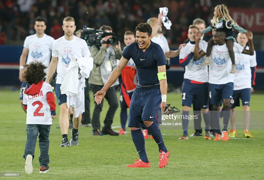 Captain Thiago Silva of Paris Saint-Germain celebrates the victory with his son after the French Ligue 1 between Paris Saint-Germain FC and Stade Rennais FC at Parc Des Princes on May 07, 2014 in Paris, France.