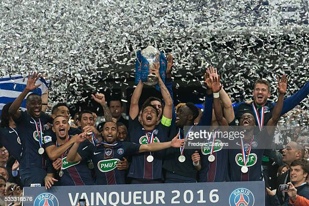 Captain Thiago Silva of Paris SaintGermain celebrates the victory with teammates during the final French Cup between Paris SaintGermain and Olympique...