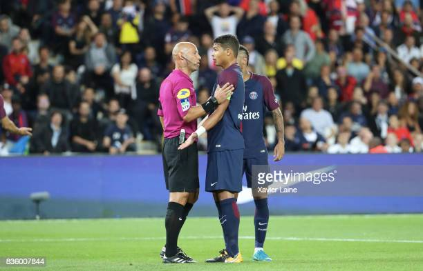 Captain Thiago Silva of Paris SaintGermain react with the referee after the red card of Marco Verratti during the French Ligue 1 match between Paris...
