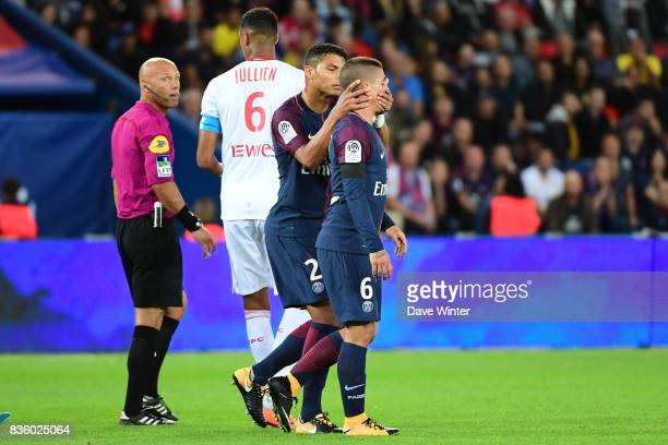 Captain Thiago Silva of PSG prevents Marco Verratti of PSG speaking to the referee after the latter receives a red card during the Ligue 1 match...
