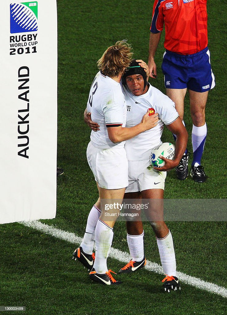Captain <a gi-track='captionPersonalityLinkClicked' href=/galleries/search?phrase=Thierry+Dusautoir&family=editorial&specificpeople=544025 ng-click='$event.stopPropagation()'>Thierry Dusautoir</a> of France (R) celebrates with teammate <a gi-track='captionPersonalityLinkClicked' href=/galleries/search?phrase=Aurelien+Rougerie&family=editorial&specificpeople=220239 ng-click='$event.stopPropagation()'>Aurelien Rougerie</a> after he scores their first try during the 2011 IRB Rugby World Cup Final match between France and New Zealand at Eden Park on October 23, 2011 in Auckland, New Zealand.