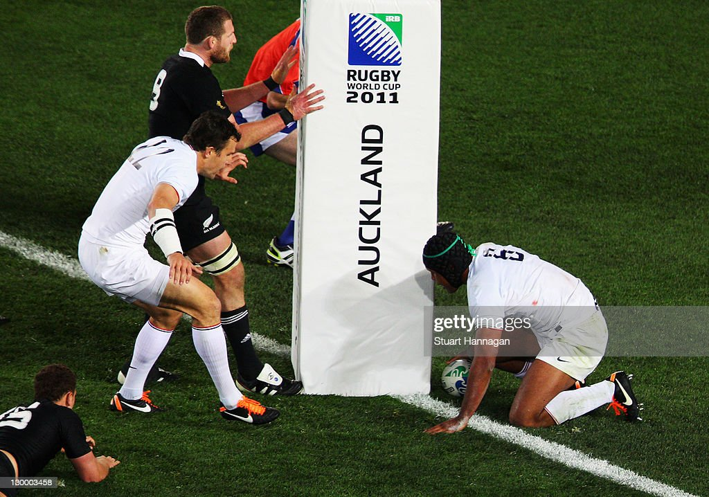 Captain Thierry Dusautoir of France (R) scores their first try during the 2011 IRB Rugby World Cup Final match between France and New Zealand at Eden Park on October 23, 2011 in Auckland, New Zealand.