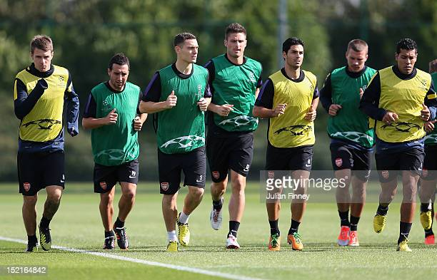 Captain Thomas Vermaelen of Arsenal leads the team during a training session at London Colney on September 17 2012 in St Albans England