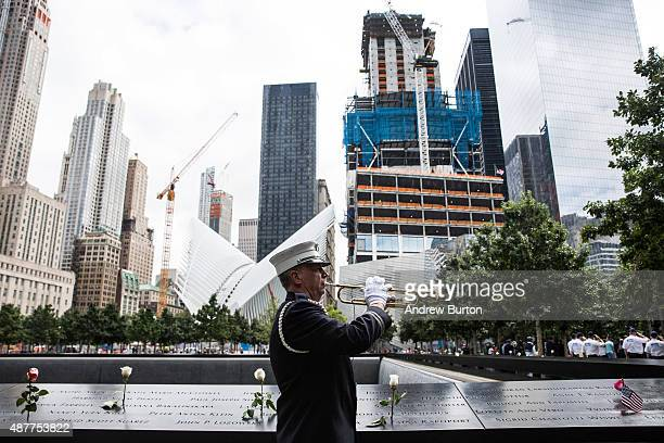 Captain Tom Engel of the New York Fire Department plays taps at the end of the ceremony commemorating the 14th anniversary of the September 11th...