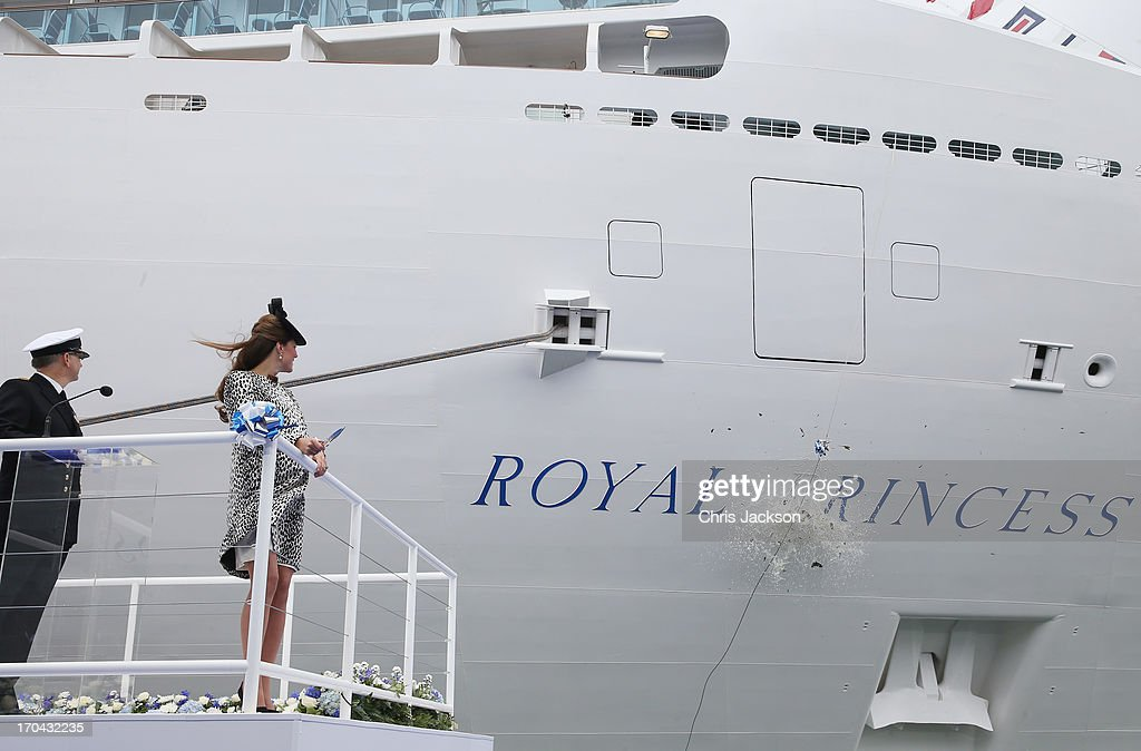 Captain Tony Draper (L) and Catherine, Duchess of Cambridge watch the bottle of Moet & Chandon Brut Imperial Champagne break against the ship for the Princess Cruises naming ceremony at Ocean Terminal on June 13, 2013 in Southampton, England.