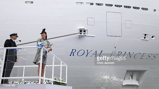 Captain Tony Draper and Catherine Duchess of Cambridge watch the bottle of Moet Chandon Brut Imperial Champagne break against the ship for the...