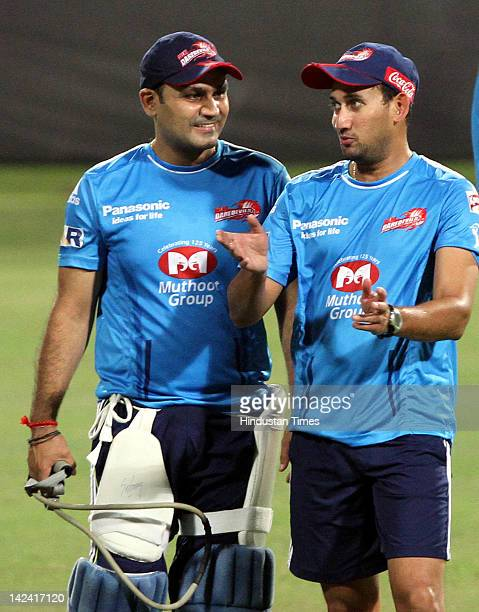 Captain Virender Sehwag of the Delhi Daredevils talks with teammate Ajit Agarkar during net practice at Eden Gardens on April 4 2012 in Kolkata India...