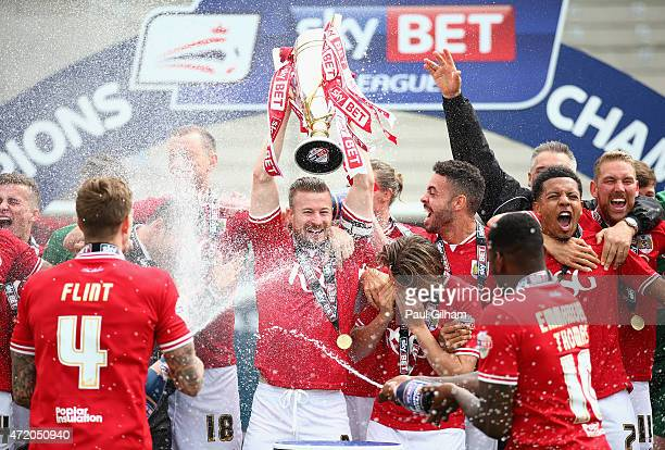 Captain Wade Elliott and the Bristol City players and management celebrate winning the league during the Sky Bet League One match between Bristol...