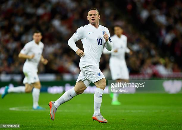 Captain Wayne Rooney of England in action during the UEFA EURO 2016 Group E qualifying match between England and Switzerland at Wembley Stadium on...
