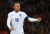 Captain Wayne Rooney of England looks on during the EURO 2016 Qualifier between England and Lithuania at Wembley Stadium on March 27 2015 in London...
