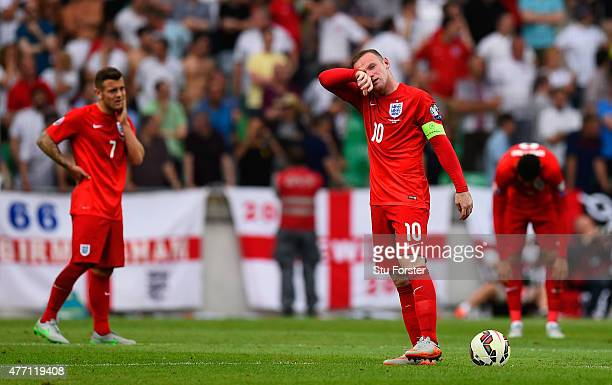 Captain Wayne Rooney of England prepares to restart after conceding the first goal during the UEFA EURO 2016 Qualifier between Slovenia and England...