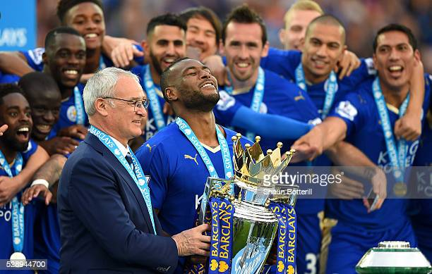 Captain Wes Morgan and manager Claudio Ranieri of Leicester City prepare to lift the Premier League Trophy after the Barclays Premier League match...