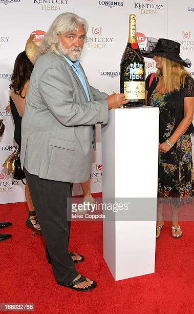 Captain 'Wild' Bill Wichrowski from the show 'Deadliest Catch' signs the Moet Chandon 6L for the Churchill Downs Foundation during the Kentucky Derby...