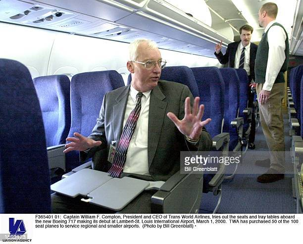 Captain William F Compton President and CEO of Trans World Airlines tries out the seats and tray tables aboard the new Boeing 717 making its debut at...