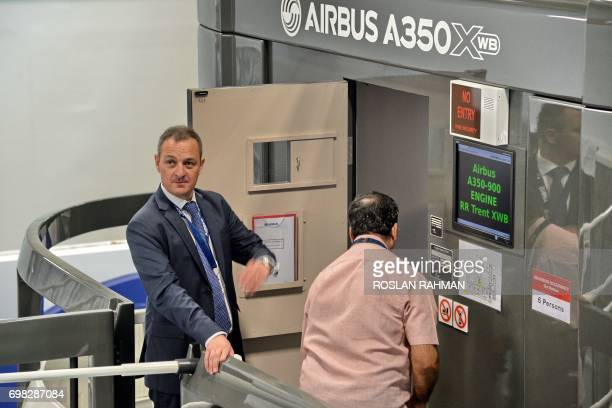 Captain Yann Lardet General Manager of AATC Airbus prepares to go board the simulator of the A350 XWB during a media tour of the Airbus Asia Training...
