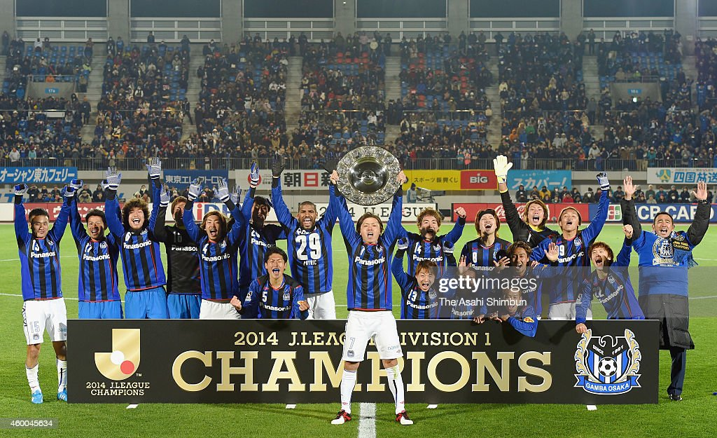 Captain Yasuhito Endo (C) lifts the trophy as they won the 2014 J.League season champion after the 0-0 draw in the J.League match between Tokushima Vortis and Gamba Osaka at Naruto Otsuka Sports Park Pocari Sweat Stadium on December 6, 2014 in Naruto, Tokushima, Japan.