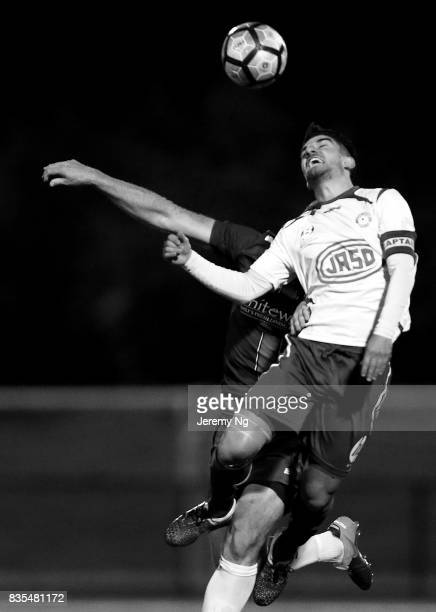 Captain Yianni Spyrakis of Sydney Olympic is tackled during the NSW NPL 1 Elimination Final between Manly United FC and Sydney Olympic FC at Cromer...