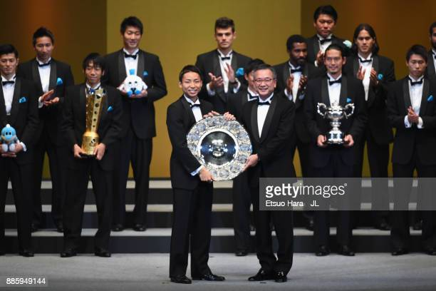 Captain Yu Kobayashi of Kawasaki Frontale receives the JLeague J1 Champions Trophy by JLeague Chairman Mitsuru Murai during the 2017 JLeague Awards...