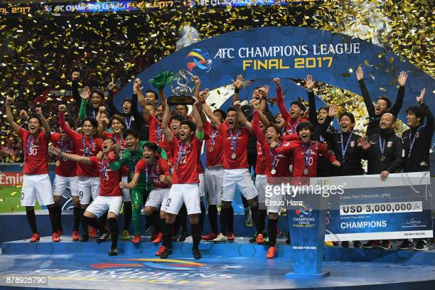 captain Yuki Abe of Urawa Red Diamonds lifts the AFC Champions League trophy at the award ceremony during the AFC Champions League Final second leg...