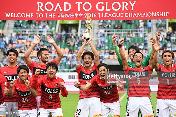Captain Yuki Abe of Urawa Red Diamonds lifts the trophy after winning the JLeague second stage after the JLeague match between Jubilo Iwata and Urawa...