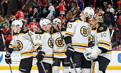 Captain Zdeno Chara and goalie Tuukka Rask of the Boston Bruins celebrate with the team after defeating the Chicago Blackhawks 62 during the NHL game...