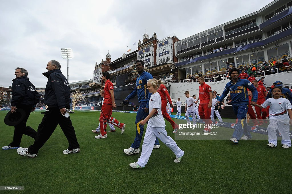 Captains Alastair Cook of England and Angelo Mathews of Sri Lanka lead their teams onto the field during the ICC Champions Trophy Group A match between England and Sri Lanka at The Oval on June 13, 2013 in London, England.