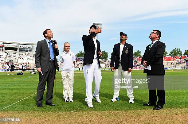 Captains Alastair Cook of England and MS Dhoni of India toss the coin before kick off with Michael Atherton and Match Referee David Boom during Day 1...