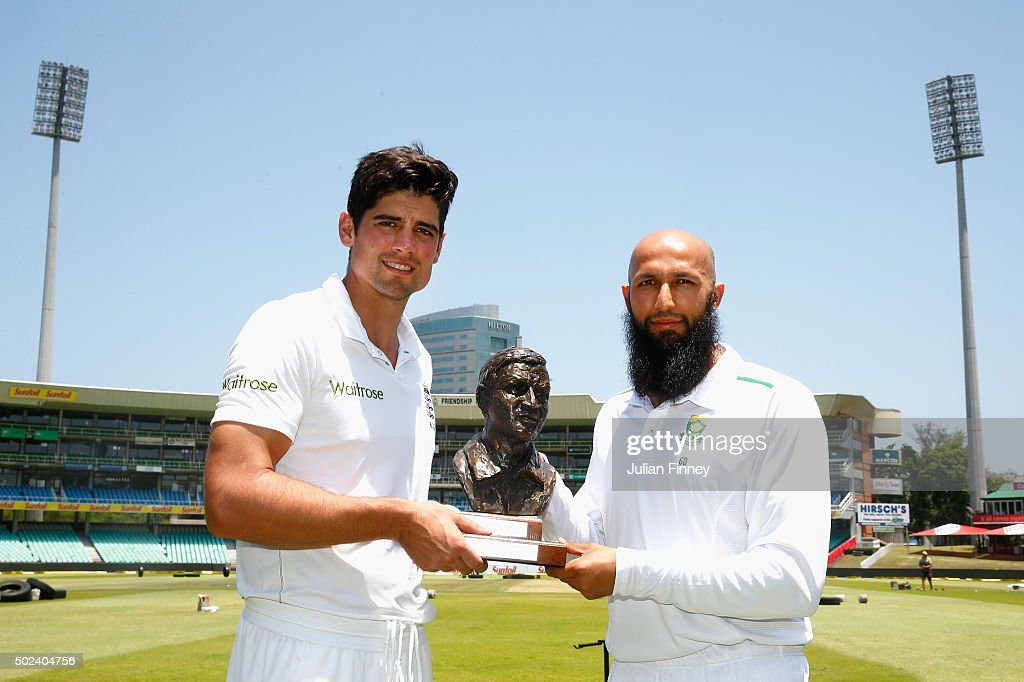 Captains <a gi-track='captionPersonalityLinkClicked' href=/galleries/search?phrase=Alastair+Cook+-+Cricket+Player&family=editorial&specificpeople=571475 ng-click='$event.stopPropagation()'>Alastair Cook</a> of England and <a gi-track='captionPersonalityLinkClicked' href=/galleries/search?phrase=Hashim+Amla&family=editorial&specificpeople=647392 ng-click='$event.stopPropagation()'>Hashim Amla</a> of South Africa pose with the Basil D'Oliveira trophy after England nets and training session at Sahara Stadium Kingsmead on December 24, 2015 in Durban, South Africa.
