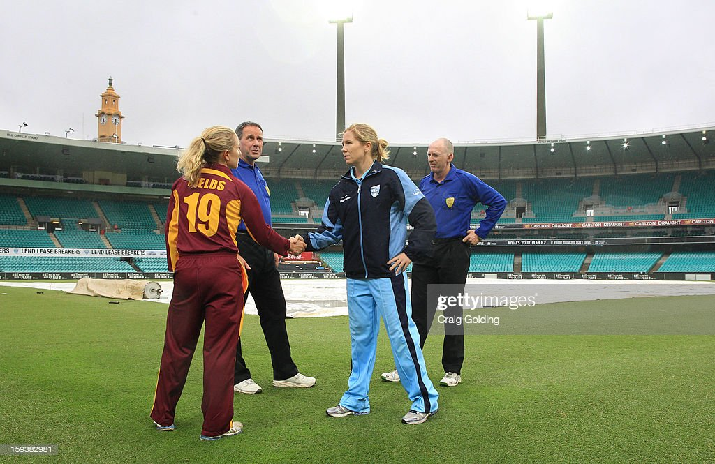 Captains Alex Blackwell of the Breakers and Jodie Fields of the Fire shake hands in the centre of the SCG after umpires called off play because of rain. NSW winning under the Duckworth- Lewis system. The WNCL Final match between the NSW Breakers and the Queensland Fire at the Sydney Cricket Ground on January 13, 2013 in Sydney, Australia.