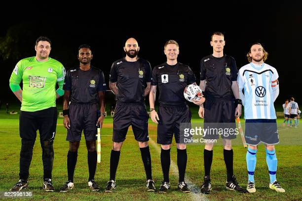 Captains Angelo Konstantinou of Canberra Olympic FC and Daryl Platten of Sorrento FC with the match officials during the FFA Cup round of 32 match...
