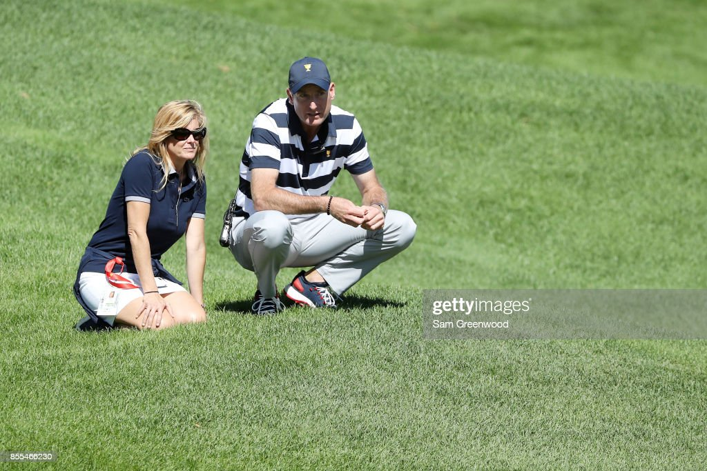 Captain's assistant Jim Furyk of the U.S. Team and his wife Tabitha Furyk look on during Thursday foursome matches of the Presidents Cup at Liberty National Golf Club on September 28, 2017 in Jersey City, New Jersey.