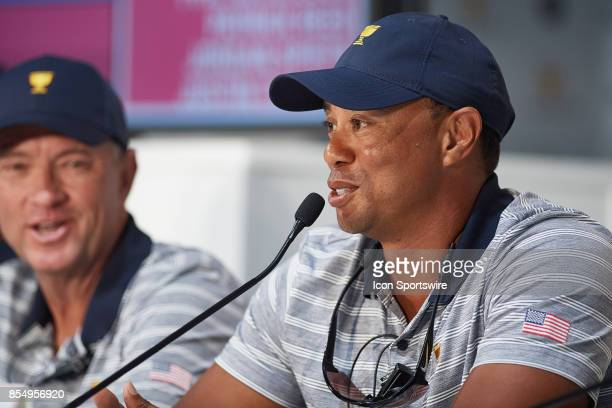 Captain's Assistants Tiger Woods and Davis Love III of the American Team are interviewed after practice rounds prior to the Presidents Cup at Liberty...