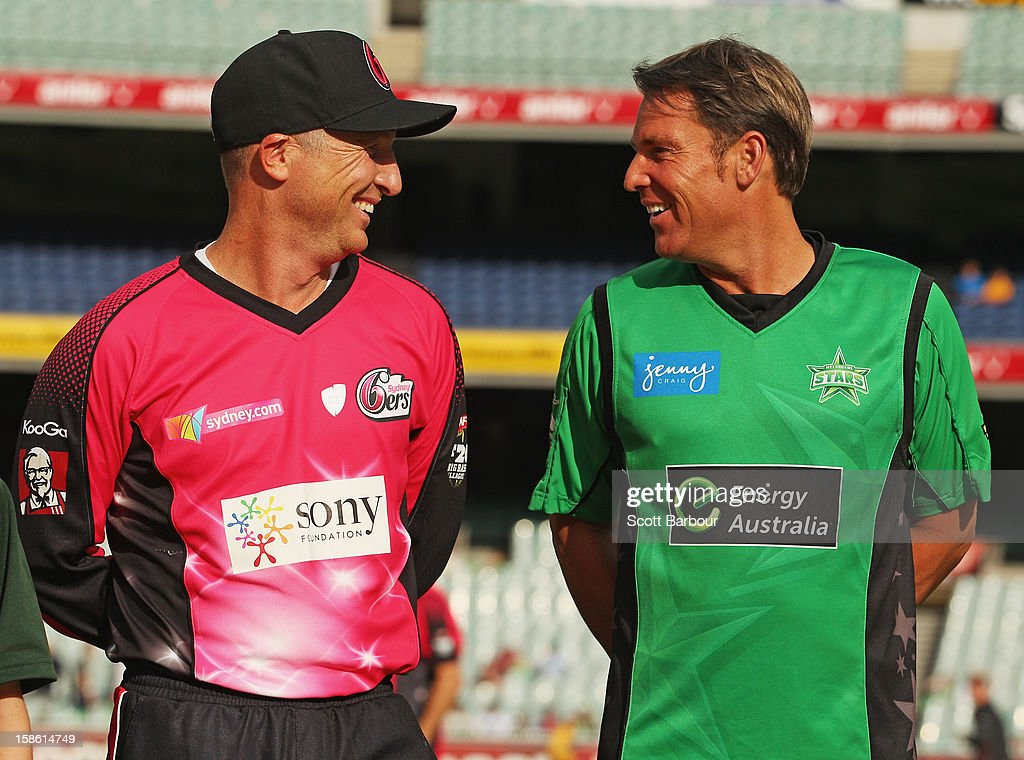 Captains Brad Haddin of the Sixers and <a gi-track='captionPersonalityLinkClicked' href=/galleries/search?phrase=Shane+Warne&family=editorial&specificpeople=167242 ng-click='$event.stopPropagation()'>Shane Warne</a> of the Stars talk before the coin toss during the Big Bash League match between the Melbourne Stars and the Sydney Sixers at Melbourne Cricket Ground on December 21, 2012 in Melbourne, Australia.