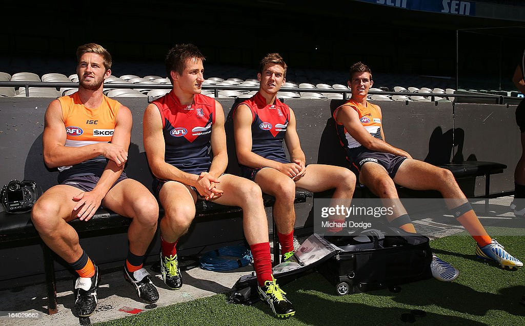 Captains Callan Ward (L) and Phil Davis (R) talk with Melbourne Demons captains Jack Grimes and Jack Trengove during the AFL Captains media Day at Etihad Stadium on March 19, 2013 in Melbourne, Australia.
