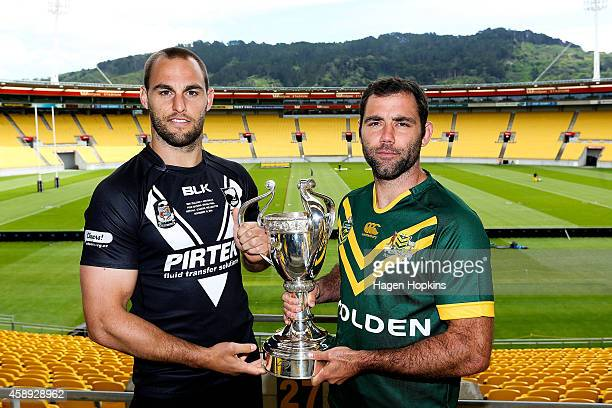 Captains Cameron Smith of the Kangaroos and Simon Mannering of the Kiwis pose with the Four Nations Cup during a joint New Zealand Kiwis and...